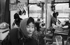 Untitled (andrew.cantarutti) Tags: old travel people blackandwhite woman fish monochrome look work fishing looking fishermen market working korea busan angry oldwoman southkorea fishmarket selling snarl upset frustrated jagalchi fishforsale