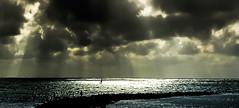 The watcher (Steve-h) Tags: light sea sun man black nature yellow clouds grey pier spain mediterranean shadows yacht aquamarine andalucia costadelsol andalusia sunrays malaga marbella