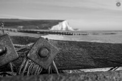 Old Rope (| APeRture Photography UK |) Tags: wood uk sea england blackandwhite white seascape black beach water sussex coast nikon focus europe dof mud sigma blurred rope bolt sevensisters groyne whitecliffs bnw hama hoya cuckmere landsca