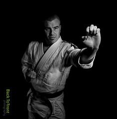 Allard -0160 (Back to Front Photography) Tags: white man black sports monochrome muscles kick taekwondo karate sword knight actor push strength allard samoerai wwwbacktofrontnu