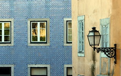 Coloured facades (Croix-roussien) Tags: street city blue urban portugal yellow architecture lanterne facade jaune lisboa bleu rue lisbonne croisement mosaiques