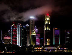 Banking Lights (Meredith Lewis) Tags: lighting cloud color colour building tower architecture night skyscraper buildings dark singapore colorful asia skyscrapers towers newyear coloredlights colourful sg padang uobplaza republicplaza singaporeisland hsbcbuilding bankofchinabuilding colouredlights downtowncore oubcentre maybanktower onerafflesplace ocbccentre 6batteryroad pickeringoperationscomplex pulauujong