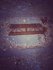 Puddle Reflections (Saromat (photographs by Sarah B.)) Tags: reflection industrial landschaftspark duisburg industrie ruhrgebiet spiegelung regen landschaftsparknord ruhrpott pftze bergbau