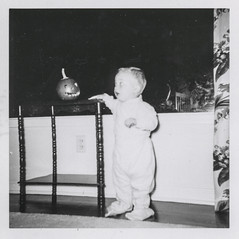 Little boy is startled by a tiny jack-o-lantern (simpleinsomnia) Tags: old boy white black halloween monochrome vintage found blackwhite kid child little jackolantern antique snapshot photograph vernacular scared littleboy foundphotograph