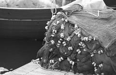 Fishing nets (Federico Pitto) Tags: bw d76 genova hp5 nikonfe2 nikkor135mm28