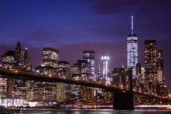 Manhattan through the Bridge (ChecaPablo) Tags: new york bridge blue sunset newyork brooklyn night sunrise canon atardecer eos dawn lights luces manhattan amanecer hour brooklynbridge 7d bluehour nueva nuevayork horaazul canoneos7d