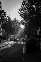 Early morning runner (Luis Alvarez Marra) Tags: street morning light bw white black monochrome 35mm spain nikon candid catalonia luis unposed alvarez salou tog marra d7000