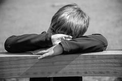 DSC_0881 (jameshowardphotography) Tags: boy white black eye monochrome contrast fence mono hands child