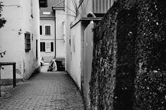 Next to the dark wall (Leica Minilux) (stefankamert) Tags: street leica city people blackandwhite bw film wall analog 35mm blackwhite xp2 sw ilford balingen minilux summarit stefankamert