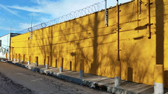 Glowing Yellow Building, Strip District, January 30, 2016 (real00) Tags: alley bollard business industrial landscape pittsburgh rustbelt urban urbanlandscape wall