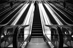 ... one ... (ines_maria) Tags: vienna wien street city urban bw reflection monochrome lines silhouette person candid escalator streetphotography symmetry hauptbahnhof sw spiegelung rolltreppe sdbahnhof