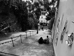 Version 2 (danielrieu) Tags: blackandwhite bw paris france wall graffiti couple noiretblanc montmartre nb mur escalier amoureux affiches