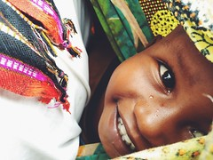 Baby Fraini (marielinden4) Tags: africa baby nature beautiful smile true tanzania happy colorful poor culture clear grateful tradition cloth gratitude
