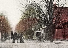 Armstrong Street looking towards the Post Office, Crothersville, Indiana, close-up section (Hoosier Recollections) Tags: horses people usa man color men buildings clothing workmen mail postoffice indiana streetscene porch shops pedestrians storefronts grocery buggy buggies businesses wagons lampposts crothersville
