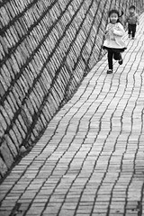 the chase (Andy Kennelly) Tags: china street bw kids children photography candid strangers streetphotography running run chase macau thechase