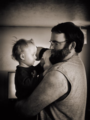 Father & Son (Colormaniac too (Back & SLOWLY catching up)) Tags: portrait bw closeup blackwhite toddler child candid father son monotone collection nik filters tenderness spontaneous iphone