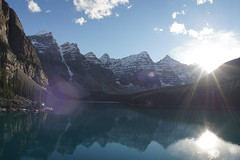 Moraine Lake Sunset (ryan.kole32) Tags: travel trees sunset lake snow canada reflection nature beauty clouds forest landscape rockies outdoors evening hiking sony bluesky alberta banff sunburst rockymountains mirrorimage moraine banffnationalpark morainelake canadianrockies valleyofthetenpeaks banffalberta beautyinnature sonya77