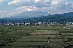 Mt Fuji, 1976 (NettyA) Tags: travel mountain japan clouds landscape japanese asia fields kodachrome 1976 mtfuji scannedslide fromtrain 35mmslidefilm