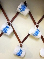 Cups Hanging On The Wall. (dccradio) Tags: lumberton nc northcarolina robesoncounty diamondshape cupholder mugholder coffeecup coffeemug teacup teamug hotchocolatecup hotchocolatemug cup mug wall decor decoration corelle bluevelvet flower rose bluerose floralprint photooftheday pictureoftheday picaday picoftheday dailyphoto project365