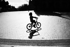 Cycling through Red Square. Seattle, WA. March 2016. (poopoorama) Tags: seattle boy shadow blackandwhite bike bicycle silhouette washington engagement eric child unitedstates heather streetphotography fujifilm redsquare universityofwashington xseries dannyngan wclx100 x100t dannynganphotography