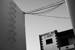 El Quijote (willjackson.eu) Tags: street white black wall 35mm restaurant islands spain nikon g ladder canary nikkor f18 puertodelcarmen arre d40x rawtherapee f18g lanzaro