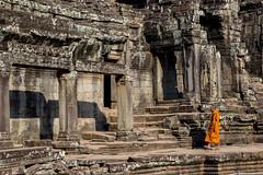 Monk @ Bayon, Angkor Thom, Angkor, Cambodia (Danil den Toom) Tags: orange heritage walking site cambodia monk unesco holy siem reap sacred thom angkor wat bayon cambodja worldwonder