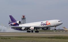 FedEx MD 11 Smoking (coreybrickner) Tags: plane msp smoking landing fedex md11 trijet kmsp