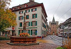 The Holbein Fountain and Spalentor (City Gate) at Spalenvorstadt, Basel (PhotosToArtByMike) Tags: switzerland swiss basel rhine ch citygate spalentor grossbasel spalenvorstadt spalengate baselswitzerland gateofspalen holbeinfountain oldtownbasel