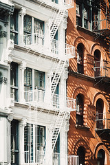 SoHo's facades (Gabriela Tulian) Tags: street city nyc newyorkcity urban usa house ny newyork detail building home window closeup skyline architecture loft stairs facade skyscraper outdoors cityscape exterior realestate apartment manhattan background soho nobody symmetry minimal line simplicity ladder minimalism shape outsidestairs