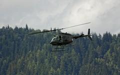 """Austrian Bell OH-58B """"Kiowa"""" 3C-OJ @ LOXZ (stecker.rene) Tags: clouds forest canon austria exercise bell military sigma airshow helicopter airpower minigun vfr kiowa zeltweg eos450d aerialdisplay oh58 flyingdisplay hinterstoisser austrianairforce 150500mm loxz oh58b airpower11 airpower2011 3coj"""