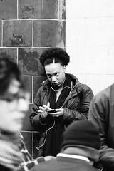 Waiting for a while (Natalia Strokan) Tags: uk blackandwhite bw woman london waiting phone streetphotography gaze camdentown annoyed candidphotography sonydscrx10