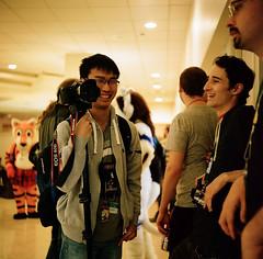 75410001 (algolec1990) Tags: city tlr film laughing portraits photo furry michigan candid group lion canine fox convention medium format motor raccoon yashica con spontaneous novi fursuit 2016 fursuits