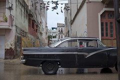 Havana: car and shoes, symbols old and new (Salle-Ann) Tags: street urban graffiti shoes cuba hanging