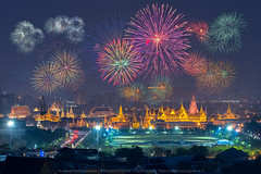 The Grand Palace Fireworks (KRW_GNS) Tags: new city travel blue light sky holiday building tourism skyline architecture night river landscape thailand temple fire twilight colorful asia king cityscape place fireworks bangkok buddha buddhist traditional famous year religion culture royal buddhism grand landmark firework palace celebration thai wat