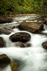 Waterfalls along Avalanche Creek In Glacier National Park, MT - 20150804CRN (Christopher Neel Photography) Tags: park art nature water creek outdoors photography timelapse montana rocks time hiking fine christopher glacier adventure boulders trail national traveling cobbles milky neel lapse avalanche