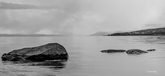 A night in April III (Jim Skarli) Tags: blackandwhite bw lake seascape nature water monochrome norway landscape outdoors mono spring nikon scenery rocks stones april serene scandinavia seashore greyscale mjsa