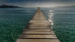 enjoy the moment (hjuengst) Tags: water spain wasser turquoise jetty perspectives mallorca woodenbridge horizont spanien mediterraneansea perspektive majorca steg balearen boardwalks alcudia trkis holzbrcke sunreflections sonnenreflektionen