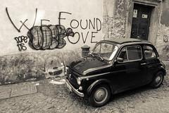 We Found Love (Steven J Parkes) Tags: italy rome car blackwhite classiccar fiat graffitti cult 500 ragtop fiat500 backlane lightroom blackcar 24105mm streetsofrome calassic canon5dmkii wefoundlove