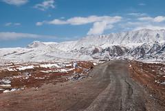 Bumpy road lead to Kizil Art Pass (Michal Pawelczyk) Tags: road trip holiday snow mountains bike bicycle june nikon asia flickr aim tajikistan centralasia pamir gory wakacje 2015 czerwiec azja d80 pamirhighway gbao azjasrodkowa tadzykistan azjacentralna