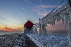 Grand Haven sunset (Notkalvin) Tags: winter sunset lighthouse lake cold ice beach water evening pier frozen outdoor michigan lakemichigan arctic shore iced icy frigid catwalk grandhaven mikekline notkalvin notkalvinphotography
