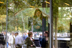 Memorial Reflections (Torsten Reimer) Tags: nyc newyorkcity woman usa newyork window reflections us memorial unitedstates fenster unitedstatesofamerica worldtradecenter 911 mobilephone northamerica 911memorial reflektionen spiegelungen worldtradecentermemorial