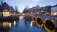Keizersgracht & Leidsegracht, Amsterdam (Mike Cialowicz) Tags: longexposure travel bridge holland netherlands amsterdam night canal europe sony canals bluehour keizersgracht leidsegracht rokinon a6000 12mmf20