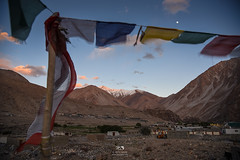 Moonshine over Tangste (Color Odyssey) Tags: travel sunset moon india mountains nature landscape outdoors colorful village scenic roadtrip flags himalayas ladakh travelphotography landscapephotography tangste