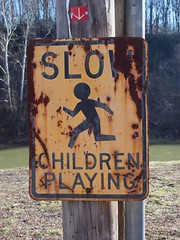 doing it old school (photography_isn't_terrorism) Tags: playing sign yellow children pc rust play rusty oldschool stickfiguresinperil faded rusted childrenatplay wimpy stickfigureinperil bullying fadedsign childrenplaying wimps sickfigure
