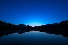 Blue morning (petia.balabanova) Tags: morning travel blue sky lake reflection water sunrise landscape mirror switzerland ticino traveling svizzera paesaggio montains 1735mm nikond800