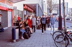Waiting for Megabus (Nodding Pig) Tags: uk greatbritain england film bicycle 35mm bristol waiting shoppingcentre scan passengers transparency he bondstreet broadmead passersby 2016 agfachrome ct100 pentaxsp1000 takumar55mm 20150705a030101