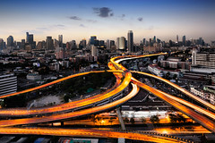 Traffic and light trails (Krunja) Tags: road street city bridge red urban abstract motion blur building tower car skyline architecture modern night speed dark way landscape thailand lights evening moving movement twilight highway automobile long exposure downtown driving cityscape view traffic motorway dusk bangkok background transport trails fast blurred landmark scene business lane transportation vehicle concept th krungthepmahanakhon