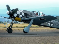 With his plane bearing the insignia of the WWII Luftwaffe, an aircraft enthusiast prepares to dogfight at the 2014 Air Show of the Cascades in Madras, Oregon (mharrsch) Tags: oregon vintage airplane aircraft aviation wwii madras airshow mharrsch airshowofthecascades