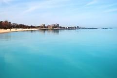 Beautiful blue lake (mmcpix) Tags: park blue chicago beach water spring skies lakemichigan shore rogers lakefront