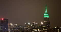 Empire State Building goes green (apardavila) Tags: nyc newyorkcity skyline skyscraper manhattan empirestatebuilding chryslerbuilding hoboken